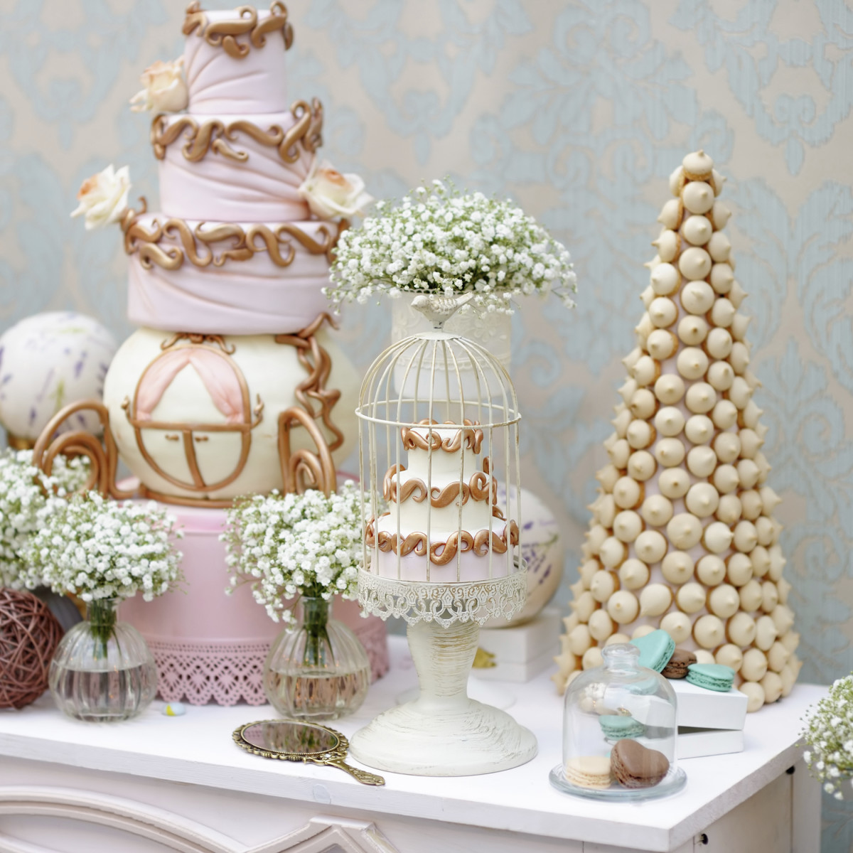 Elegant sweet table with big cake and macaroon